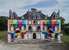 okuda san miguel canvasses 19th century castle with mulitcolored mirrored skulls