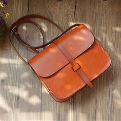 This beautiful minimalist crossbody bag is handmade with high quality top grain leather and each bag is unique with precision and love. It is