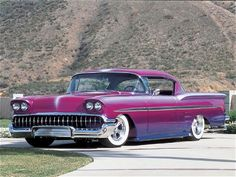 58 Impala....wow-what a paintjob!  SealingsAndExpungements.com... 888-9-EXPUNGE (888-939-7864)... Free evaluations..low money down...Easy payments.. 'Seal past mistakes. Open new opportunities.'