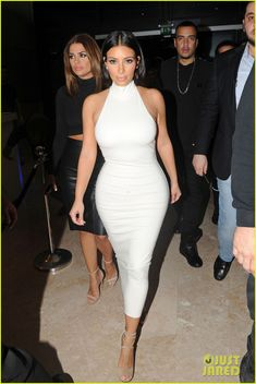 kim kardashian parties with french montana surprises the troops 05 Kim Kardashian looks white hot while posing on the carpet during a night on the town at VIP Club on Sunday evening (November 23) in Abu Dhabi, United Arab Emirates.…