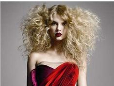 Wild Bouffant Hairstyles - Appearing as though she's prepared to both star and dance in a Def Leppard video instead of a cover shoot for Allure Magazine, Taylor Swift i...