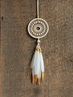 Handmade car dreamcatcher. Car rear view mirror pendant. This dreamcatcher can an excellent decoration for your home also, and an excellent gift for family members or friends.. I used only natural materials: metal hoop, cotton thread, wooden beads, small hand painted goose feathers.  Size: diameter 2,3 (6 cm) lenght 8 (20,5 cm) exclude upper thread You can adjust length of upper thread by yourself.  Color may vary slightly due to the color calibration of each individual monitor…