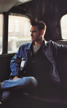 Morrissey is he tiny or is he in the back of a giant car?