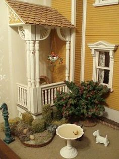 great site for miniatures with tons of tutorials    I have a little birdbath like that one, and never thought of putting it in with my mini's.  Came in a greenhouse, (looks like a little Gazebo), with the birdbath, fir tree and little bench.