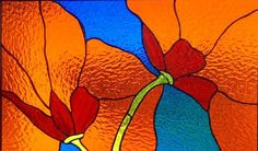 This stained glass artwork was made in my studio, Tristans stained glass in Durango, Co. It is bold and exciting. Available in orange or red.
