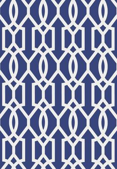 Downing Gate Wallpaper A striking wallpaper featuring an interlinking geometric pattern printed in navy and white.
