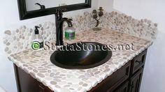 Sliced Tan Pebble Tile Bathroom Sink & Backsplash