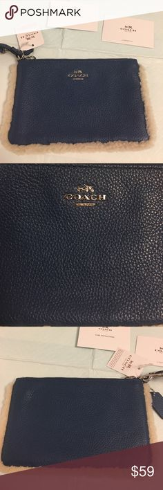 Coach slate blue shearling lined leather wristlet This is a new attack coach slate blue leather wristlet with shearling trim around the edges. Zip top closure. Comes with coach hang tag and care cards Coach Bags Clutches & Wristlets