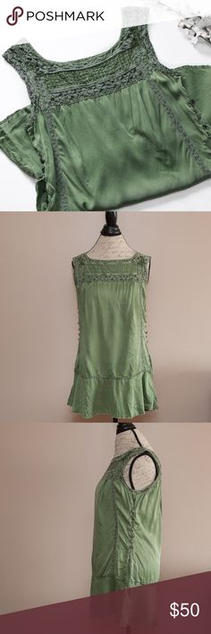 Free People Army Green Silk Drop Waist Dress Absolutely gorgeous Free People dress! Pull over style. Features drop waist with frayed raw edges and side button detail. Buttons are just for decoration and serve no actual purpose. Minor flaws - a small black dot on the front & 3 tiny bleach-like stains, a small black mark near the left armpit, There is a line of snags on the left side that line up with the buttons, and the right side is missing one button. These are not super obvious flaws…