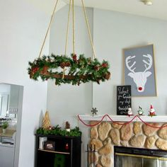 Ceiling Hung Wreath: 10 Tutorials and Christmas Decorating Ideas - See all 10: http://www.familyhandyman.com/smart-homeowner/10-tutorials-and-christmas-decorating-ideas