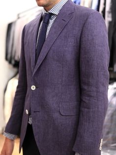 wool & linen purple jacket. I'd like this fabric on you. Fuck that cut and those buttons though, looks sloppy.