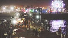 The Santa Monica Pier is an iconic Los Angeles landmark that comes alive at night from the Ferris wheel to games with prizes. Free Things To Do, After Dark, Santa Monica, Getting To Know, Stuff To Do, Bright, Vacation, Beach, Vacations