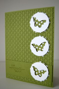 Pretty green card, use of negative space on white circles to make butterflies