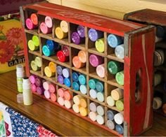 -Finding new uses for vintage items is a great way to organize your craft paints in a vintage Coke crate.