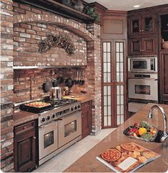 Bricks are working for me with the gas stove and arch abvoe it -and the pantry glass paneled doors -sweet!