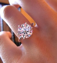A perfect round cut 4.8CT Tiffany Style (6 prong) Russian lab diamond with a basket setting. It's BIG, classic, stunning and has lots of fire. This is a must for every wardrobe. Special occasions, pro