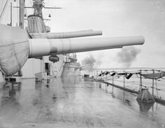 Gunnery practice aboard 15 in 'R' class battleship HMS Royal Oak in 1918: her secondary starboard 6 in battery has just fired.  Royal Oak went on to be sunk by U 47 inside Scapa Flow in October 1939 with heavy loss of life.