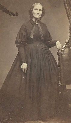 CDV PHOTO ELDERLY WOMAN STANDING IN LARGE DARK COLOR HOOP DRESS CIVIL WAR ERA