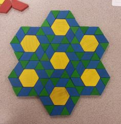 Tessellations are defined as a pattern of shapes that fit perfectly together, and is when you cover a surface with a pattern of flat shapes so that there are no overlaps or gaps. Pattern Block Templates, Pattern Blocks, Math Patterns, Block Center, Wooden Pattern, Ecole Art, Beautiful Rangoli Designs, Pattern Images, English Paper Piecing