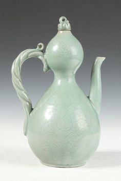 KOREAN CELADON PORCELAIN DOUBLE GOURD EWER, Koryo Dynasty or later. - 11 1/4 in. high.