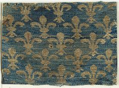 Textile with Fleur-De-Lis Motif Date: 13th century Geography: Made in Sicily, Italy Culture: Italian Medium: Silk, metal thread Accession Number: 46.156.54