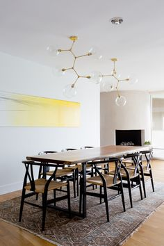 dining room, live edge dining table, wishbone chairs, brass chandeliers, organic modern