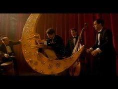From Sweet and Lowdown (1999), a story of fictional jazz guitarist, Emmet Ray, who idolizes Django Reinhardt and wears a very charming constellation-embroidered tux for this paper moon stage blunder.
