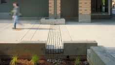 Stephen Epler Hall @ PSU / Portland, OR - granite gutter into stormwater planter