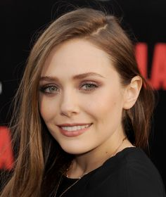 Elizabeth Olsen's smolders in burgundy eye makeup as she arrives at the Los Angeles premiere of 'Godzilla'. via @stylelist
