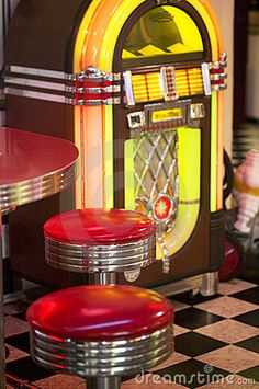 50's Diner Decor ~ Black & White Checkerboard Tile Floor, Juke Box, and Vintage Bar Top & Stools
