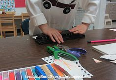 Teaching 2 and 3 Year Olds: Hole  Punching at the Fine Motor Table
