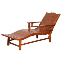 Vintage Teak Dutch Colonial Influenced Lounge Chair   From a unique collection of antique and modern chaise longues at https://www.1stdibs.com/furniture/seating/chaise-longues/