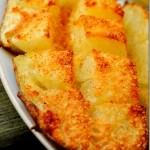 Cook potato in the microwave (6-7 minutes). Cut in half lengthwise.  Score down  to the skin making squares in each half.  Season with parmesan cheese, butter and Lawrey's seasoning salt.  Broil on aluminum foil lined pan placed on middle rack of oven for 10-15 minutes.