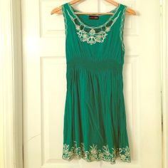 Green sundress Green sundress - only worn once. White pattern at top and bottom (very comfortable) zio Dresses
