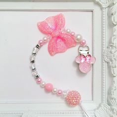 Light pink Minnie mouse pacifier clip with rhinestones and bow foe Disney fans Bling Pacifier, Pink Minnie, Minnie Mouse, Pram Charms, Baby Bling, Dummy Clips, Baby Girl Gifts, Baby Disney, Handmade Accessories