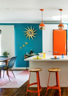 Mid-century modern meets colour splash in the WA team's family home
