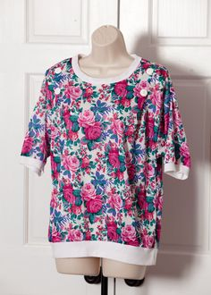 A personal favorite from my Etsy shop https://www.etsy.com/listing/265806519/vintage-80s-womens-top-rose-floral