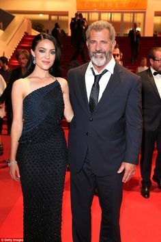 Controversial: Mel Gibson, 60, has vehemently defended his romance with former equestrian vaulter Rosalind Ross, 26, (pictured together in May) who is expecting his ninth child