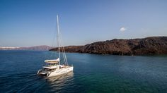 For the ultimate getaway, snorkel in crystal clear waters and relax on pristine sandy beaches with one of Sunset Oia's catamarans!