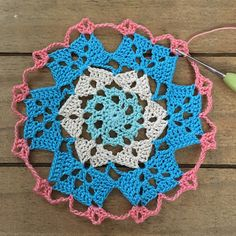 Free written This doily is called Ocean Breeze and is 17 rounds and measures about 8 It's colorful and fun to make! The colors I used are- . Crochet Circle Pattern, Free Crochet Doily Patterns, Crochet Circles, Crochet Motif, Free Pattern, Crochet Ideas, Crochet Coaster, Crochet Pillow, Crochet Granny