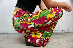 www.flarestreet.com These flares are inspired by the psychedelic times of the late 1960s, particularly Janis Joplins painted car! The colours are intertwined in a way that resembles everything designed by The Fool. Theyre a mix of brilliant green, pink, yellow and black. The velvet fabric has a glimmer and shine to it and is super soft to touch. You wont be able to take your eyes off them, theyre a dream. These bells fit a size 8/10/12 (US size 2-6). See below for exact measurements. See…