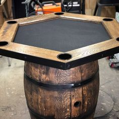 Spanish Oak wine barrel poker table Color: Spanish Oak Features: Made from authentic reclaimed wine/whiskey/bourbon oak barrels 40 inch oak top Aluminum cup holders Dimensions: Height 39 inches, top 40 inch radius, barrel 27 inch radius Poker Table Diy, Custom Poker Tables, Automotive Decor, Automotive Furniture, Automotive Locksmith, Automotive Group, Wine Barrel End Table, Game Room Bar, Game Rooms