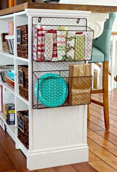 Magazine rack, hung from cabinet for extra hand towels.