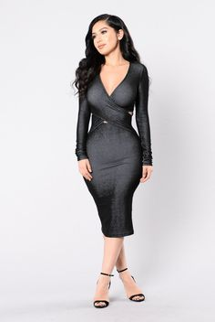 """- Available in Black - Long Sleeve Midi Dress - Fitted - """"V"""" Neck - Wrap Bust Detail - Made in U.S.A - 53% Polyester 45% Rayon 2% Spandex"""
