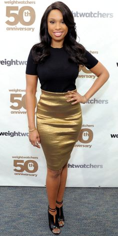 Jennifer Hudson celebrated the 50th anniversary of Weight Watchers in a Donna Karan gold pencil skirt, Christian Louboutin booties and black t-shirt.