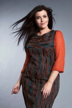 Ria dress with wool sleeves and front slit.   http://www.dealondon.co.uk/ria-knitted-sleeves-dress