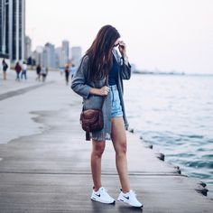 cute sneakers, white nike airmax, travel outfit, chicago outfit, denim highwaisted shorts, grey chicwish cardigan, v-neck tee, pretty in the pines fashion blog, fossil crossbody bag, what to wear for a day trip