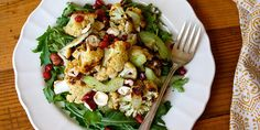 Roasting cauliflower brings out its sweet, nutty flavor that pairs perfectly with hazelnuts and pomegranate seeds. Get our roasted cauliflower salad recipe.