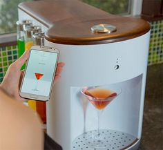 Somabar Robotic Bartender - $399  Somabar is a Wi-Fi connected craft cocktail appliance created specifically for the home. Yes, a robotic bartender that will mix 'em up while you enjoy the party. You simply fill the 6 pods with the desired mixers and use the Soma app in your phone to select the drink you want. Somabar measures, mixes, stirs, shakes, and shoots out your drink in a flash.