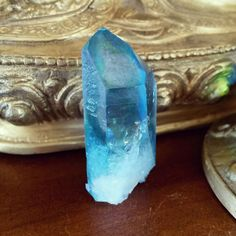 Aqua Aura A Quartz crystal bonded with Gold can only be a recipe for a psychic bullet proof shield. Harmful energies are deflected or trapped inside.